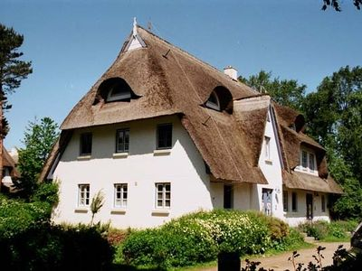 Photo for Apartment Achtern Diek in Thatched in traditional style, on the beach