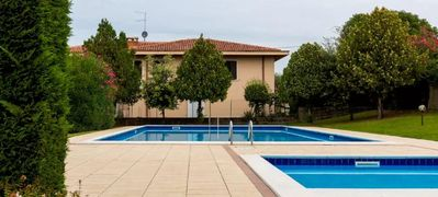Photo for Apartment in Bardolino opposite the beach with private garage and pools. Wifi.