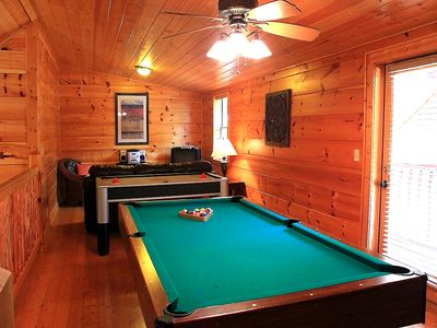game room includes regulation size pool table and air hockey table