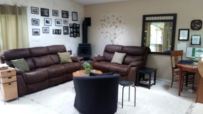 two large reclining couches (can also sleep on). Gas fireplace, desk work area