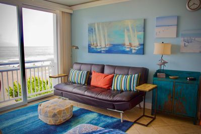 Kick back and enjoy waterfront views inside & out!