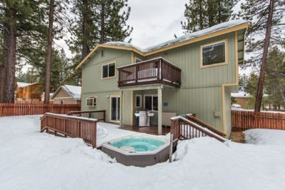 Backyard with hot tub in Winter - soak amongst the snow!