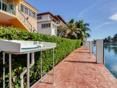 Photo for Spacious, waterfront home w/ 33-ft dock, shared pool, & Cabana Club access!
