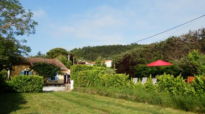 Photo for Charming cottage, sunny secluded garden & views of Pyrénées, near Carcassonne