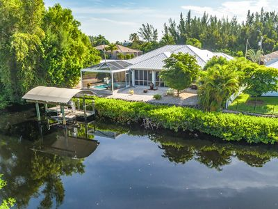 Photo for Bokeelia Breeze, 3BR Home with Private Pool & Boat Dock, Enclosed Lanai