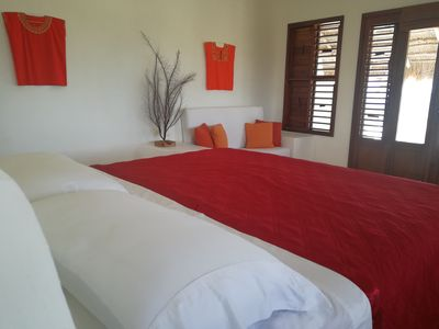 Light, spacious master bedroom with king-size bed and view over the Caribbean.
