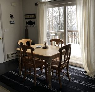 Dining table opens up to seat six.
