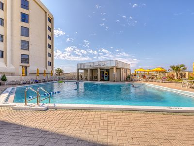 Photo for Luxurious gulf front condo w/shared swimming pool & gym! Walk to the beach!