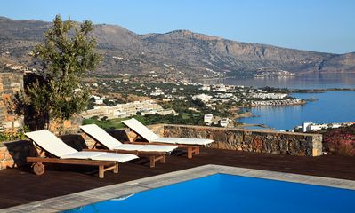 Relaxing by the pool and enjoy the views over the Elounda Bay