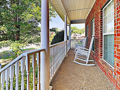 Front Porch - Classic red brick, 2 rocking chairs, and a cute front porch welcome you to this roomy Nashville house.