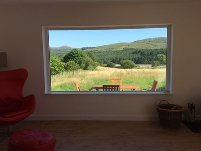 Photo for A  2 bed pet friendly holiday cottage with river access and mountain views.