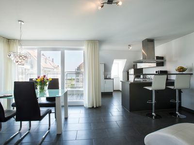 Photo for Luxury penthouse with large roof terrace, beach location, sauna & fireplace!