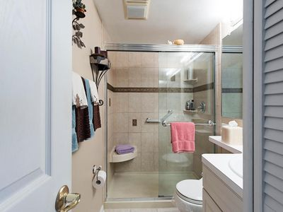 beautifully appointed bathroom with walk-in shower