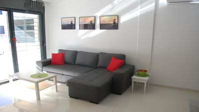 Photo for Modern apartment at 200 m from the sea with south facing terrace and swimming pool