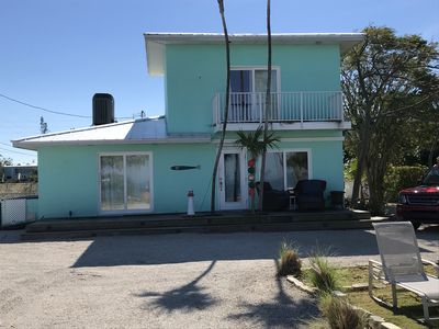 Photo for Stunning waterfront  2/2 home fully updated to a decorators dream. Pets welcome!