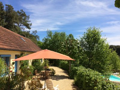 Photo for Comfortable cottage in a wooded area by the pool near Sarlat