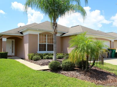 Photo for Lovely 4 Bedroom Resort Orlando Pool Home, 10 minutes from Disney/Orlando with Resort Amenities including 4 Pools, Tiki Bar and more!