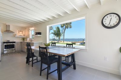 Dining rm & kitchen view amazing! Window treatments have been added for privacy