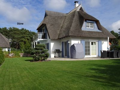Photo for Exclusive thatched cottage on the beach behind the dunes