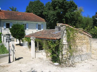 Photo for Besutiful traditional Charentaise house with private decked pool by the river