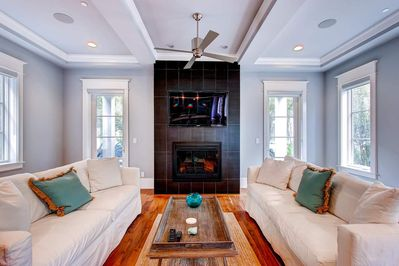 Two Sofas flank the Fireplace