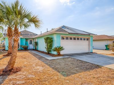 Photo for Coastal, dog-friendly home with fenced yard, grill and beach access nearby!