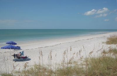 Miles of powdery white sandy beach & calm gulf waters
