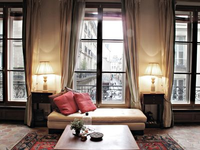 The Parisian city scape, seen from your 12-foot French windows.