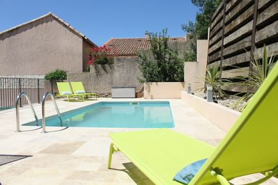 Our pool terrace offers sun or shade, for swimming, lounging, or dining.