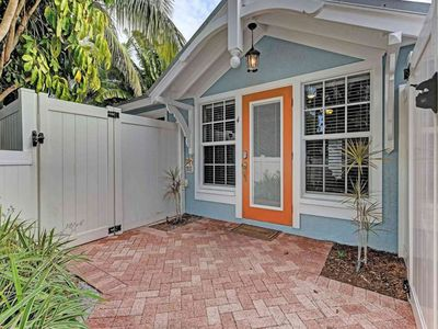 Photo for Dog-friendly beach cottage moments from the gulf with shared pool, near trolley!