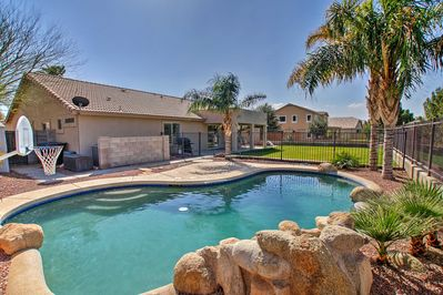 Dive into desert fun in this 4-bedroom, 2-bath vacation rental home in Gilbert!
