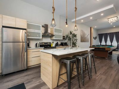 Photo for Spacious townhouse with rooftop deck 4BR near DT