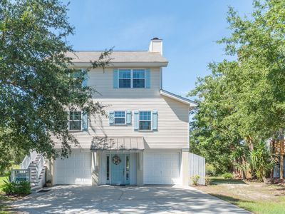 Photo for Newly renovated North End home located on tidal creek, screened in porch, and HOT TUB