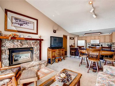 Ski-in condo with vaulted ceilings, mountain views and shared pool/hot tub