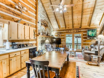 Dog-friendly, riverfront getaway w/ a private hot tub & outdoor dining area