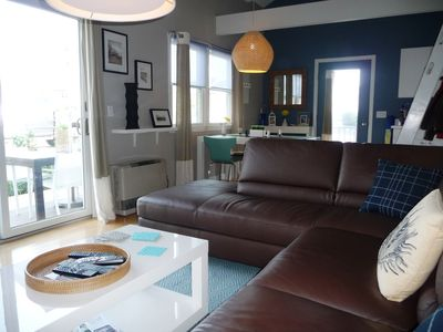 Large comfy leather sectional , view looking out to deck and dining area