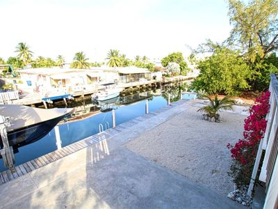 Photo for Pretty Canal-front 3/2 Family Home With Private Dock Easy Ocean Access.