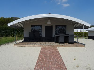 Photo for Completely furnished tent with bathroom and kitchen, located in a park with swimming pool