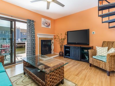 Photo for Colorful & cozy waterfront townhome w/ three balconies - walk to the beach!