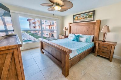 Master bedroom with great views, big screen TV and king sized bed.