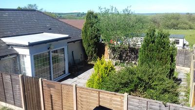 Photo for Garden flat, dog friendly, sleeps 3/4, enclosed garden, parking, level access