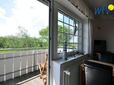 Photo for Stylish apartment with south-facing balcony and stunning views to the Watt!