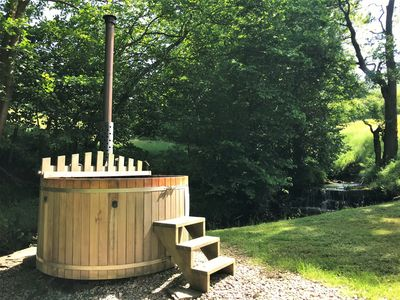 Your own private hot tub situated next to the stream - available as an optional extra