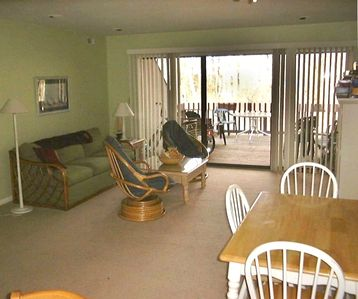 The living room and deck facing woods