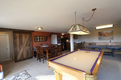 Bar-height dining table, bubble hockey, pool table