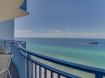 Photo for Lovely beachfront condo w/ balcony, Gulf views & shared pool/hot tub/gym!