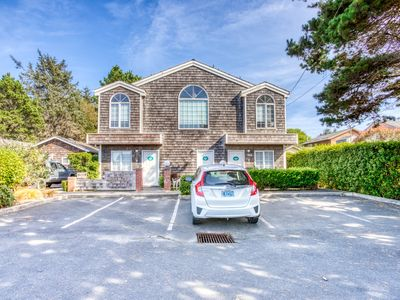 Photo for Open and dog-friendly home with forest views and two patios!
