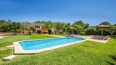 Photo for Large house with beautiful garden and pool near Can Picafort