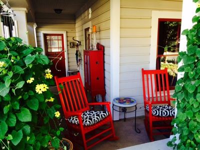 Enjoy a cup of coffee or glass of wine on the wrap-around front porch.