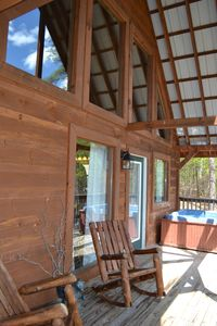 Enjoy your morning coffee in these rocking chairs or hot tub!